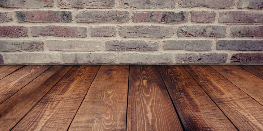 Prepare Your Home's Defences. Underfloor heating. Wooden flooring and brick wall